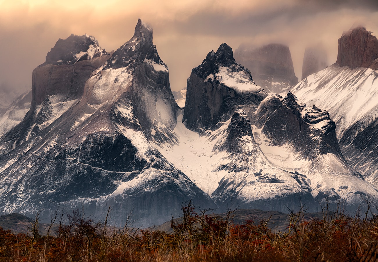 torres del paine is covered by snow during the sunset