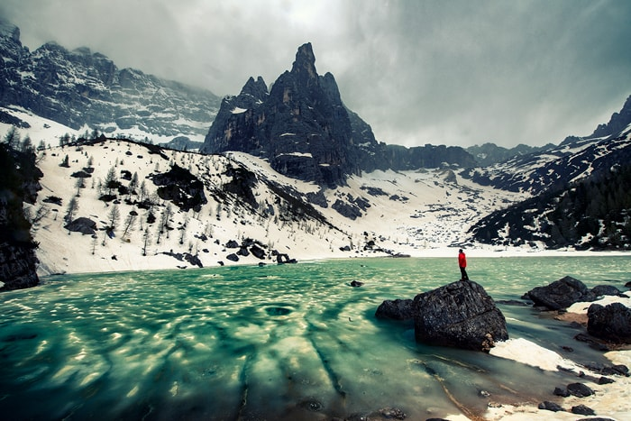 Turquoise Lake Sorapis covered with snow