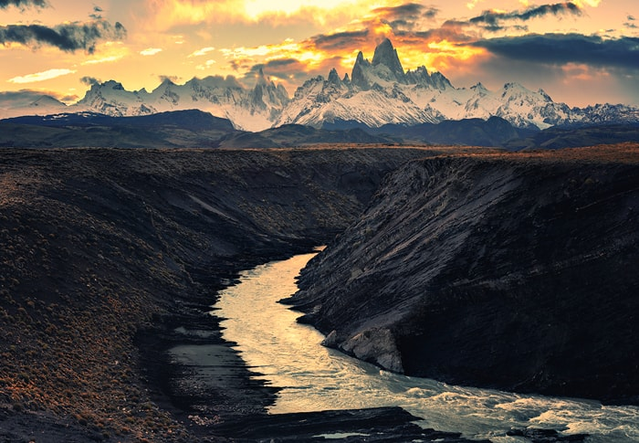 he Fitz Roy river flowing in bends beneath our feet leading the sight towards towers of Fitz Roy (Chalten) massif.