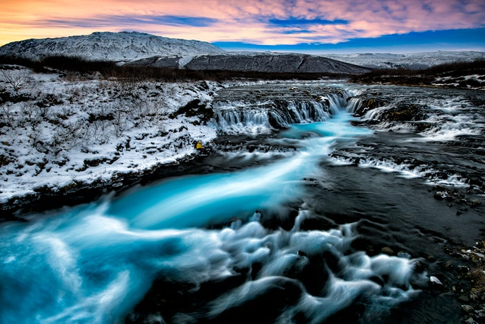 Brúarfoss ('Bridge Falls') is a relatively small waterfall compared to many of its Icelandic counterparts, but its diminutive size does nothing to take away from its staggering beauty. Both locals and seasoned travellers regard Brúarfoss as one of the country's hidden gems, often labelling it 'Iceland's Bluest Waterfall.'