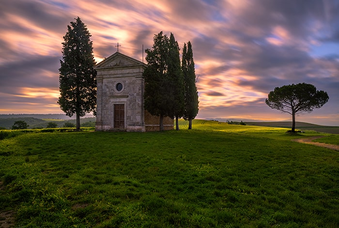 Chapel of Madonna di Vitaleta built in the middle of a hill. One of the most photographed churches in Tuscany